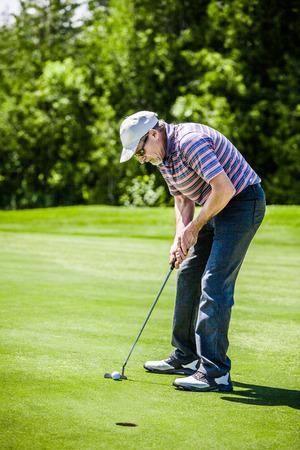 Mature Golfer on a Golf Course photo