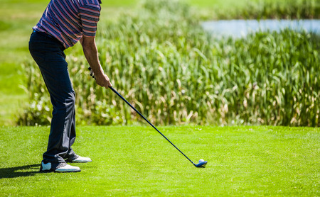 ball on water: Golfer on a Golf Course on the Start with lot of Copyspace for your text (preparation)