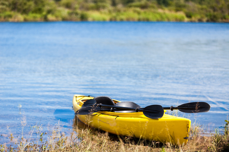 Yellow Kayak Ready to be Used on the Cost of a River photo