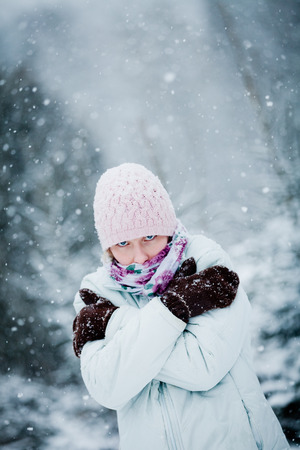 Freezing Woman during a Cold Winter Day in Nature photo