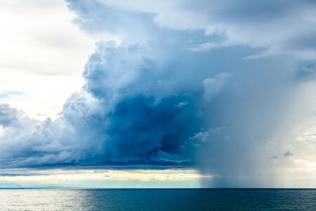 natural  moody: Rain Clouds at the Sea Horizon in the late afternoon Stock Photo