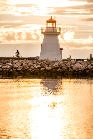 Backlit Lighthouse in Gaspe Peninsula, New Richmond, Quebec, Canada photo
