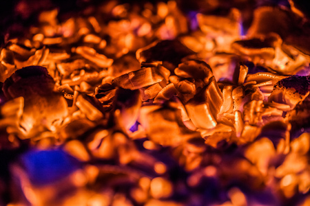 embers: Bright Orange Hot Embers in a wood Stove Stock Photo