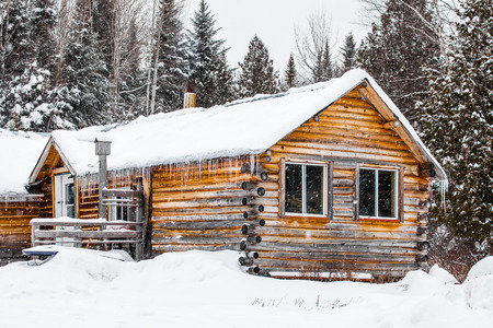 Log Wood Chalet in Quebec, Canada during a cold winter day.