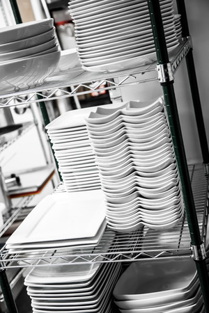 Stack of Cleaned Dishes in a Restaurant Room Stock Photo