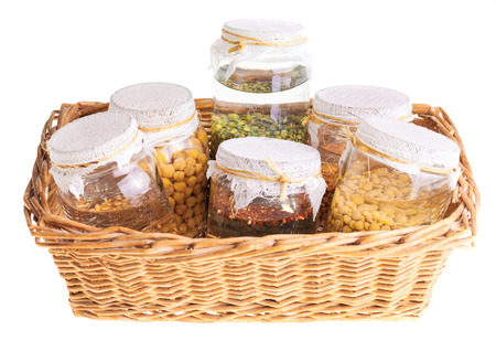 Basket of Soaked Sprouting Seeds Isolated on White Background photo