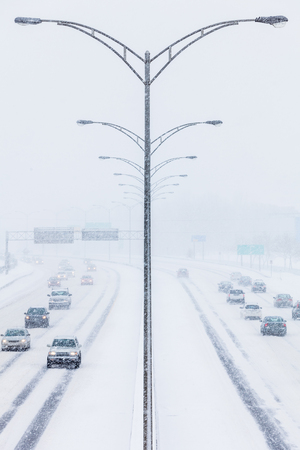 Symmetrical Photo of the Highway Center during a Snowstorm