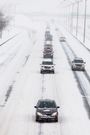 lined up: Lined up Cars on the Highway on a Snowstorm Winter day