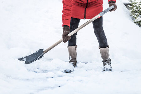 Close-up of Woman Shoveling her Parking lot after Snowstorm photo
