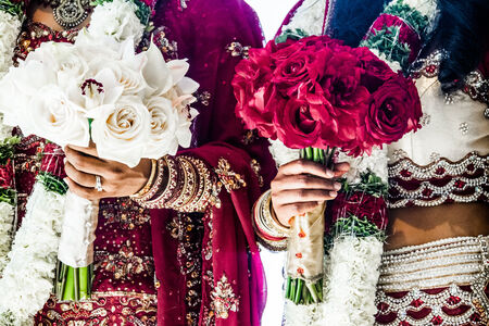 Red and White Traditional Indian Wedding Bouquets and brides Stock Photo