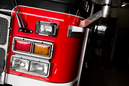 firetruck: Red Firetruck Details of the Front and Lights Stock Photo