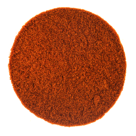 Perfect Circle of Red Spicy Pepper Powder texture isolated on White Background Фото со стока