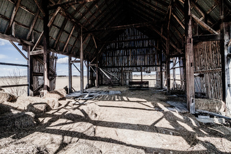 barn black and white: Old Abandoned Barn and Haystack and destroyed walls Stock Photo