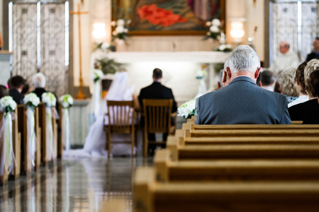 Wedding Ceremony inside a Church with Blurry Couple in Background