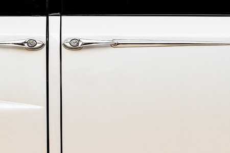 Luxurious and Vintage Beige Car Doors and Handle Detail photo