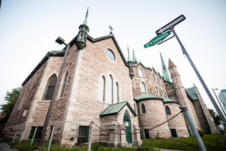 destitution: Editorial - July 24, 2014. Trois-Riviere, Quebec, Canada. The Cathedral in the Poor Old Trois-Riviere Area where the poverty is always present, but where the houses are hystorical.