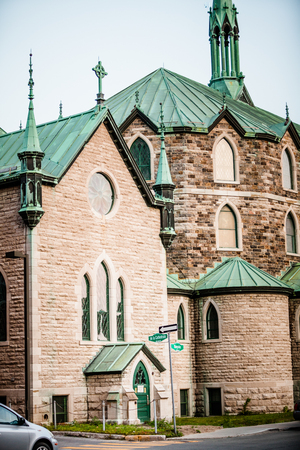 cathedrale: Editorial - July 24, 2014. Trois-Riviere, Quebec, Canada. The Cathedrale in the Poor Old Trois-Riviere Area where the poverty is always present, but where the houses are hystorical.