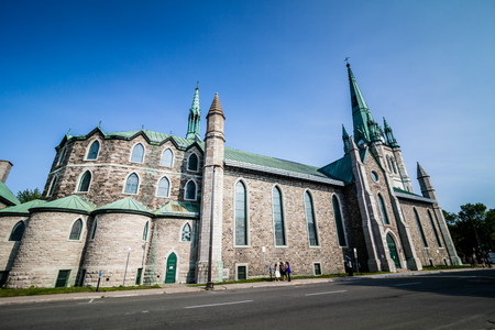 destitution: Editorial - July 24, 2014. Trois-Riviere, Quebec, Canada. The Cathedrale in the Poor Old Trois-Riviere Area where the poverty is always present, but where the houses are hystorical.