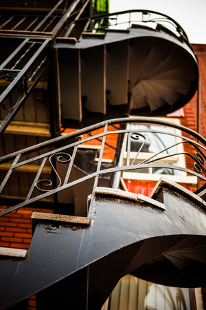 beggary: Editorial - July 24, 2014 in Trois-Riviere, Quebec, Canada. Spiral Stairs in the Poor Old Trois-Riviere Area where the poverty is always present, but where the houses are hystorical.