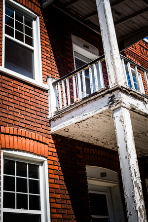 destitution: Editorial - July 24, 2014 in Trois-Riviere, Quebec, Canada. Very Old Balcony in the Poor Old Trois-Riviere Area where the poverty is always present, but where the houses are hystorical.