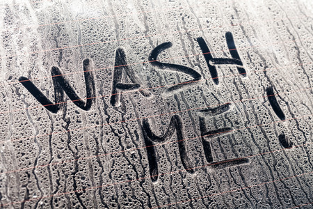 car wash: Wash Me Words on a Dirty Rear Car Window
