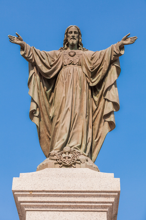 antique jesus: Outdoor Statue of Jesus with Open Arms Stock Photo