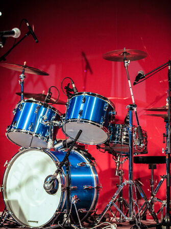 drum kit: Red Drumkit in front of Blue Background