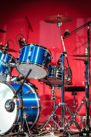 Red Drumkit in front of Blue Background photo
