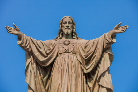 Outdoor Statue of Jesus with Open Arms Stock Photo