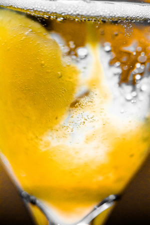 mimosa: Extreme Closeup Abstract Macro Photo of Orange Mixing with Champagne for a Mimosa
