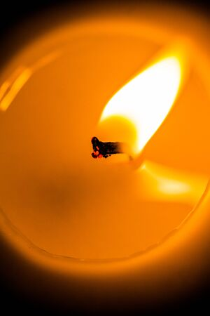 wick: Extreme Closeup of a Candle Wick Burning Stock Photo