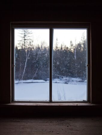 Calm Scene of Nature during Winter through the Window Pane of a Shack on a Cold Morning Stock Photo