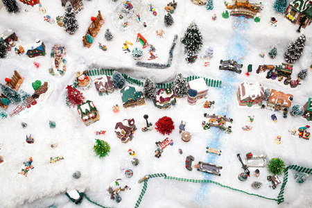 Miniature Christmas Village under Xmas Tree Texture Stock Photo