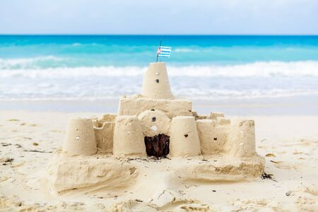 cuba flag: Cuban Sandcastle with the country Flag on one of the most Beautiful Beach of Cuba