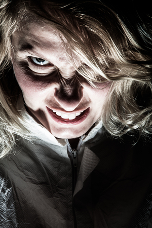 psycho: Scary Psycho Blonde Woman Frustrated and Looking at the Camera