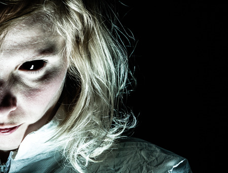 psychopath: Demon-like Woman with Black Eye Looking at the Camera