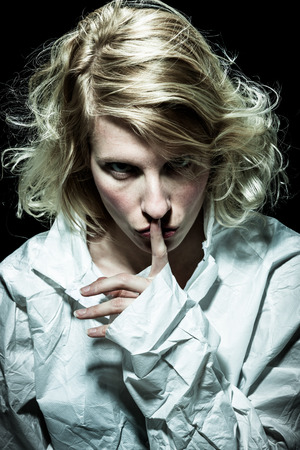 psycho: Psycho Woman asking for Silence with Finger on Lips