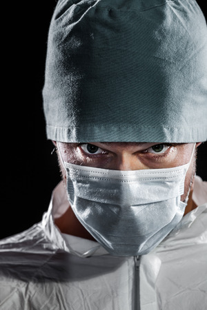 evil eyes: Freaky Doctor looking at the camera Isolated over Black Background Stock Photo