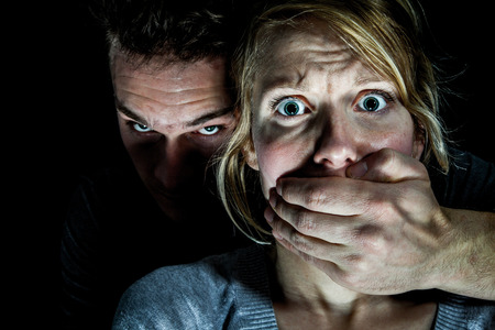 abusive man: Woman Victim put to Silence by her Boyfriend - Domestic Violence Concept