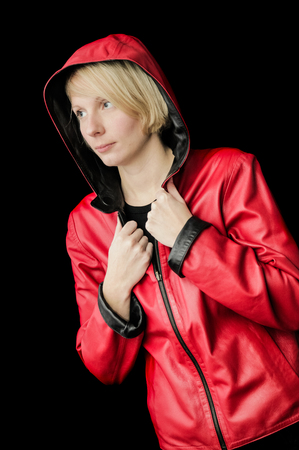 hooded vest: Woman Posing with a reversible Black and Red Leather Jacket