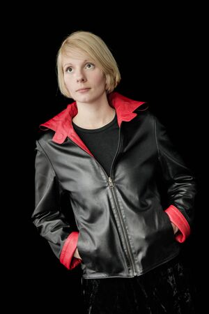 Woman Posing with a reversible Black and Red Leather Jacket
