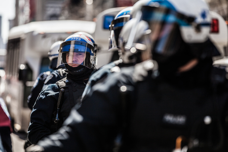 austerity: MONTREAL, CANADA, APRIL 02 2015. Riot in the Montreal Streets to counter the Economic Austerity Measures. Closeup of Cops Portraits Ready in case of Problem