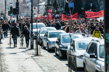 commotion: MONTREAL, CANADA, APRIL 02 2015. Riot in the Montreal Streets to counter the Economic Austerity Measures. Protesters Takes the control of the Streets