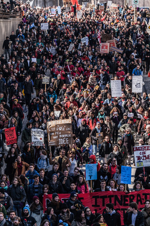 austerity: MONTREAL, CANADA, APRIL 02 2015. Riot in the Montreal Streets to counter the Economic Austerity Measures. Top View of the Protesters Walking in the Packed Streets