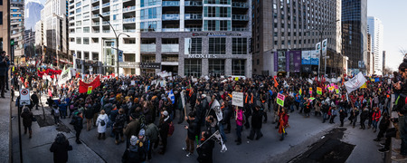 xxxl: MONTREAL, CANADA, APRIL 02 2015. Riot in the Montreal Streets to counter the Economic Austerity Measures. Panoramic View (XXXL Resolution) of the Streets Packed with Protesters