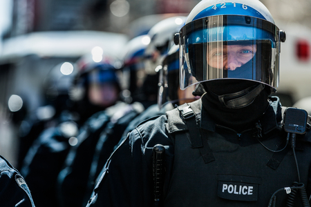 MONTREAL, CANADA, APRIL 02 2015. Riot in the Montreal Streets to counter the Economic Austerity Measures. Closeup of Cops Portraits Ready in case of Problem