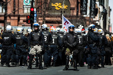 commotion: MONTREAL, CANADA, APRIL 02 2015. Riot in the Montreal Streets to counter the Economic Austerity Measures. Riot in the Montreal Streets to counter the Economic Austerity Measures.