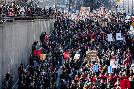 upheaval: MONTREAL, CANADA, APRIL 02 2015. Riot in the Montreal Streets to counter the Economic Austerity Measures. Top View of the Protesters Walking in the Packed Streets