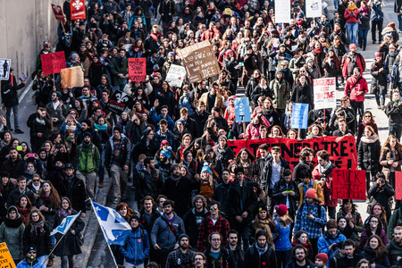 furor: MONTREAL, CANADA, APRIL 02 2015. Riot in the Montreal Streets to counter the Economic Austerity Measures. Top View of the Protesters Walking in the Packed Streets