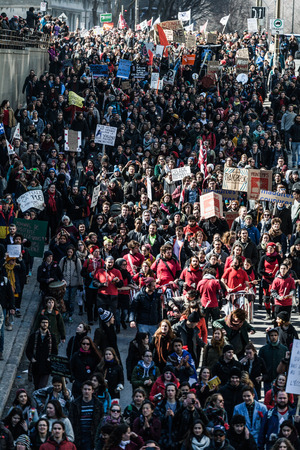MONTREAL, CANADA, APRIL 02 2015. Riot in the Montreal Streets to counter the Economic Austerity Measures. Top View of the Protesters Walking in the Packed Streets